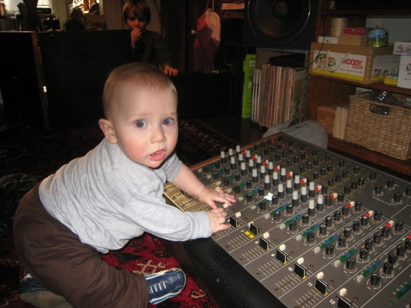 8 month old at the Sound Workshop console
